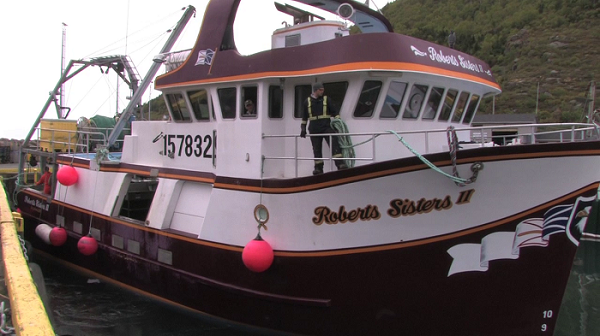 Still of a vessel docking, from the Loss of life on fishing vessels video